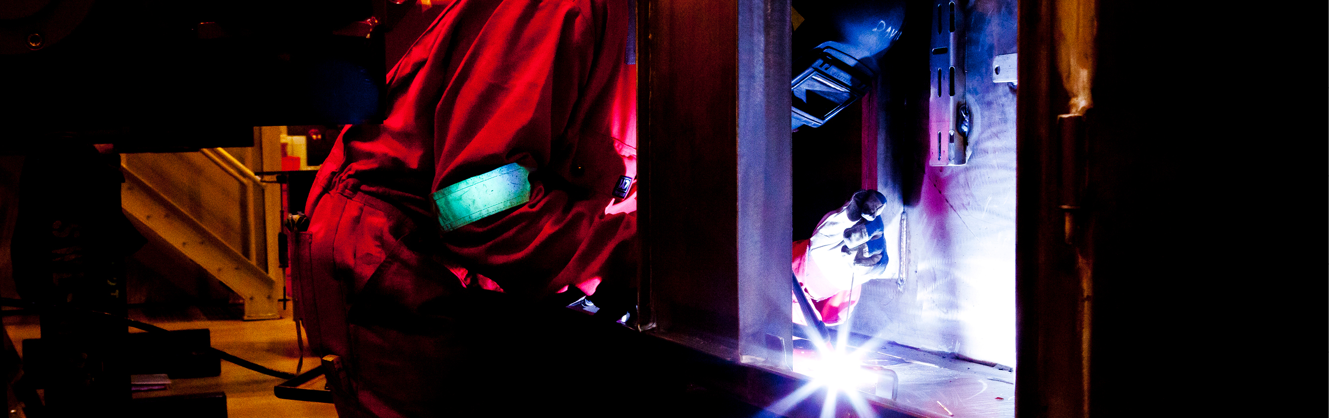 JWS Welding and Industrial Supplies banner image showing a person rod welding wearing protective clothing and welding mask